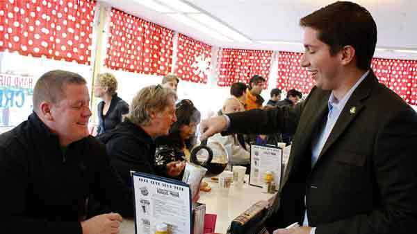 Des Plaines Ald. Matthew Bogusz pours coffee for Patrick McGeean Saturday at the Choo-Choo Restaurant in downtown Des Plaines, where Bogusz announced his candidacy for mayor in the April election.