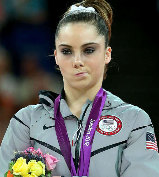 McKayla Maroney tries to hide her disappointment after being awarded her silver medal in the vault final during the 2012 London Olympics.