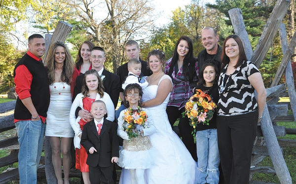 The family gathered for the wedding of Mike and Sarah Shirley at Springfield Barn in Williamsport on Nov. 5, 2011. In the front row, from left, are Dakota Anderson and Kierra Anderson. From left, in the middle row, are Amaya Shirley, Dalton Shirley, Sarah Shirley, Jazmyn Mauck and Sonya Mauck. In the back row, from left are Jeff Anderson, Ginny Anderson, Destiny Anderson, Mike Shirley, Curtis Miller, Kearstan Mauck and Jaime Mauck. This is the photo that was on the blanket Ginger took with her everywhere and with which she was buried.
