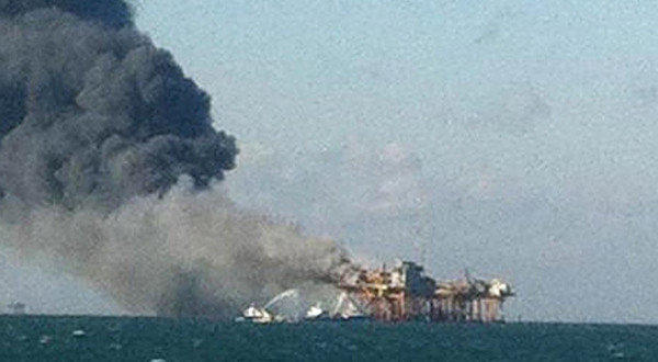 Released by an oil field worker, the image shows a fire burning on a Gulf of Mexico oil platform Friday after an explosion. Two workers were still missing Saturday.