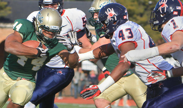 William & Mary's Meltoya Jones powers past the Richmond defense during the first half of Saturday's game.