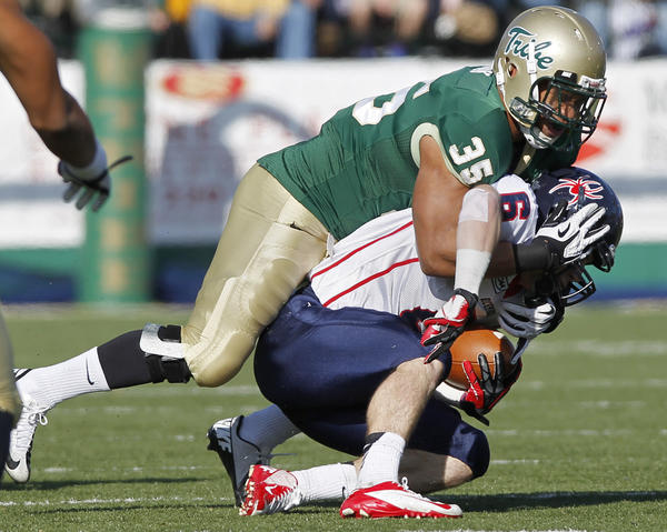 William & Mary's Dante Cook takes down Richmond's Ben Edwards during the first half of Saturday's game.