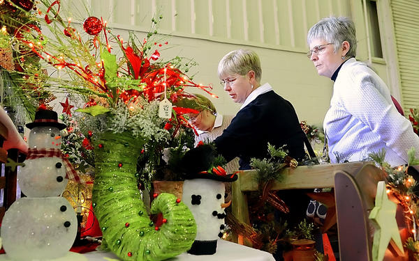 Brenda Fosnot, left, Chambersburg, Pa., and Jean Cressman of Greencastle, Pa., look over the crafts at the annual Kris Kringle Craft Show held at the ARCC on Saturday.