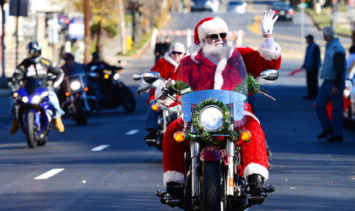 Santa, a/k/a Rick Hoffman of Macungie, leads thousands of bikers carrying gifts to the Volunteers of America building on Union Street. This was the 29th annual Toy Run sponsored by the Lehigh Valley Chapter of Alliance of Bikers Aimed Toward Education.