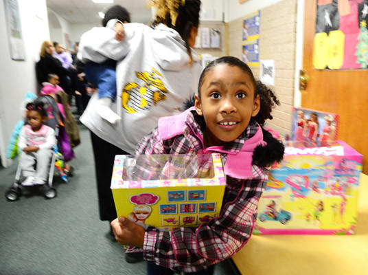 Alania Ortiz, 6, of Allentown selects a Barbie as her gift at the Volunteers of America building on Union Street. This was the 29th annual Toy Run sponsored by the Lehigh Valley Chapter of Alliance of Bikers Aimed Toward Education.