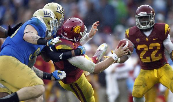 UCLA defensive end Cassius Marsh and linebacker Anthony Barr sack USC quarterback Matt Barkley in the second half Saturday.