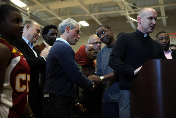 Mayor Rahm Emanuel shakes hands with Isiah Thomas at the Westside Peace Tournament at King Jesuit College Prep on Saturday.