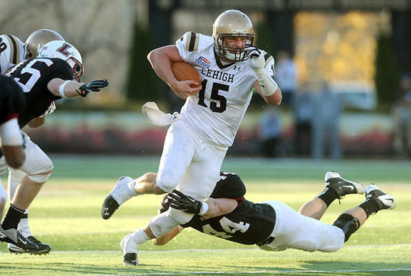 Lehigh's QB Mike Colvin (center) looks for room to run past Lafayette's Matt Gill (back) during their 148th meeting in college football Saturday afternoon. Lehigh went on to win 38-21.