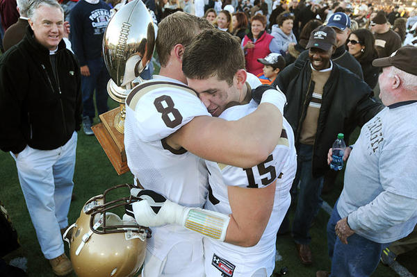 Lehigh's QB Mike Colvin (right) is congratulated by teammate Ryan Spadola (left) after he won the MVP award after defeating Lafayette College 38 - 21 in the 148th meeting Saturday afternoon.