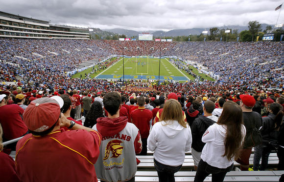 The Rose Bowl in Pasadena was packed for the UCLA-USC game on Saturday. On Monday, city leaders will vote on a plan that might bring an NFL team to the stadium for up to five years.