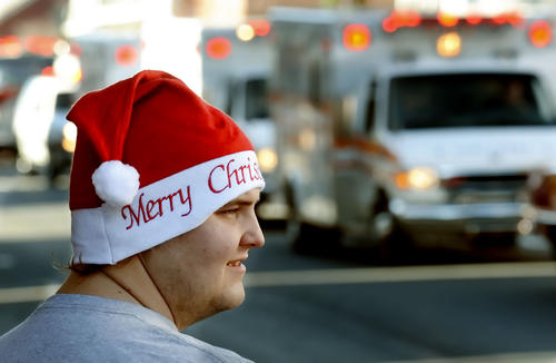 A festive Irvin Seburn of Warfordsburg watches the Holiday Parade along Main Street in Waynesboro on Saturday.