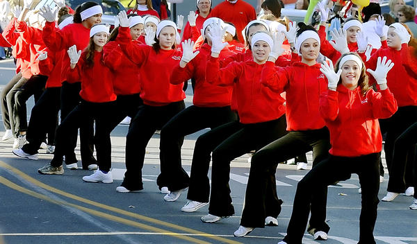 Members of A&B Dance Dimensions of Waynesboro perform in the Holiday Parade in Waynesboro on Saturday.