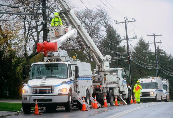 Linemen from PPL work to restore electricity on Hausman Road in South Whitehall Twp. on October 30, 2012 following Hurricane Sandy.