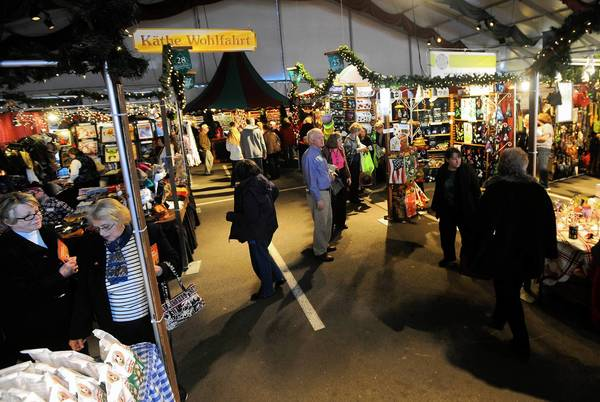 Shoppers stroll through the aisles during opening weekend at Christkindlmarkt PNC Plaza at SteelStacks in Bethlehem Saturday.