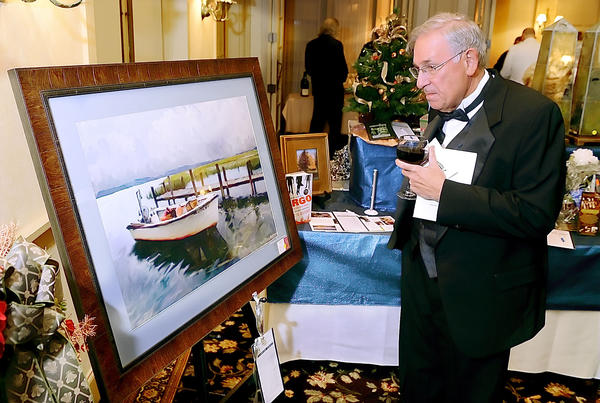 Frank Malejko of Hagerstown looks over a painting that was offered in the silent auction and the MSO's 30th Annual Symphony Ball & Auction Saturday evening.