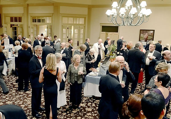 People attend a reception at the 30th annual MSO Symphony 30th annual ball and auction Saturday night at Fountain Head Country Club.