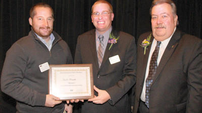 Somerset County farmer Scott Rhoads (left) won Pennsylvania Farm Bureau's 2012 Young Farmer and Rancher Discussion Meet during the 62nd annual meeting in Hershey.  Rhoads was presented the award by the State Young Farmer and Rancher Committee Chairman Mike Fink (center) and Pennsylvania Farm Bureau President Carl Shaffer.