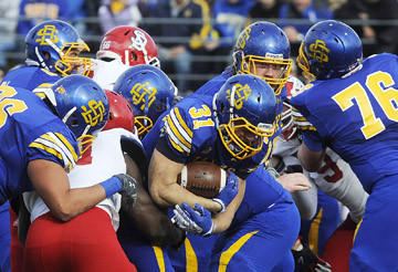SDSU's Zach Zenner (31) tries to avoid being tackled by USD in Brookings Saturday. Argus Leader Photos by Emily Spartz