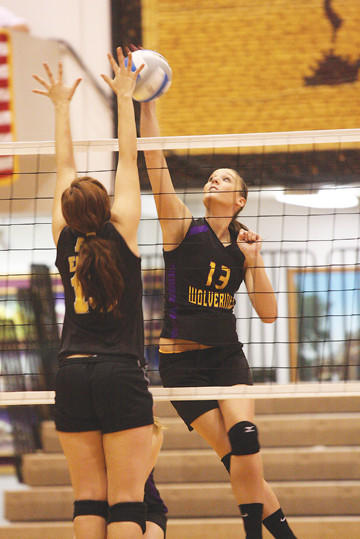 Shauni Schwartz (13) hits the ball at the fifth place State B volleyball tournament in Mitchell at the Corn Palace on Saturday.Mitchell Daily Republic Photo by Aaron Saunders