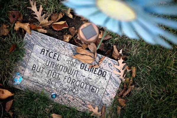 Atcel Olmedo's headstone has been modified to include his name, but it's still unclear how he died. He would have turned 10 on Nov. 5.