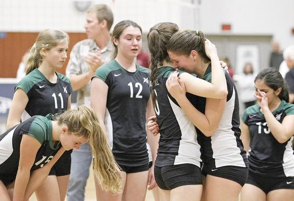 Sage Hill High's Marguerite Danner, second from right, is comforted by teammate Sophia Gordon, third from right, after the Lightning lost to St. Margaret's in a CIF Southern Section Division 3-A finals match at Cypress College on Saturday.