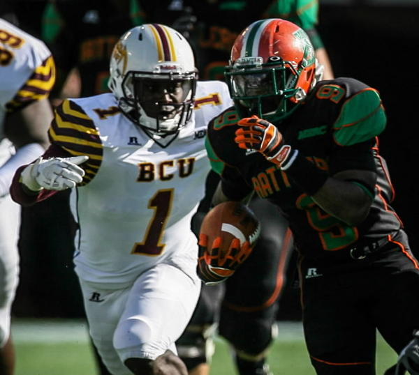 Former Sanford Seminole star Jarkevis Fields (1), now a linebacker at Bethune-Cookman, zeroes in on Florida A&M running back Eddie Rocker during B-CU's 21-16 win in the Florida Classic on Saturday, Nov. 17, 2012.