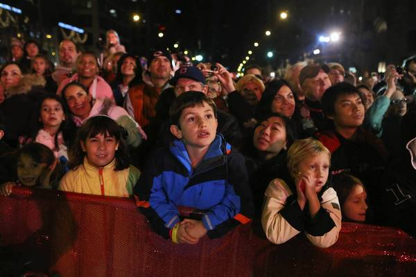 "Kids watch fireworks at the end of the <a class=""taxInlineTagLink"" id=""EVFES000072"" title=""Magnificent Mile Lights Festival"" href=""/topic/arts-culture/holidays/magnificent-mile-lights-festival-EVFES000072.topic"">Magnificent Mile Lights Festival</a> parade on Michigan Ave., Nov., 17 2012."