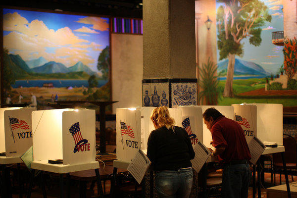 People vote at a polling place inside El Gallo restaurant in El Mercado de Los Angeles, a Mexico-style marketplace in the heavily Latino East L.A. area, during the presidential election.