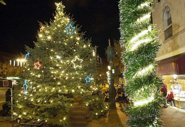 A Christmas tree stands in Public Square in this Herald-Mail file photo. The City of Hagerstown will host its annual tree-lighting ceremony in Public Square at 5 p.m. Monday, followed by the 23rd annual Hollyfest at The Maryland Theatre at 7 p.m.