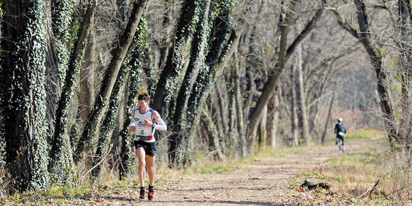 Max King, of Bend, Ore., runs all alone on the C&O Canal towpath on his way to setting the course record Saturday at the 50th annual JFK 50 Mile ultramarathon.