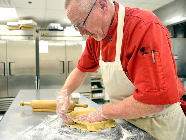 Rick Cook makes a pie crust for a pumpkin pie Friday at Icing Bakery & Cafe in Boonsboro.