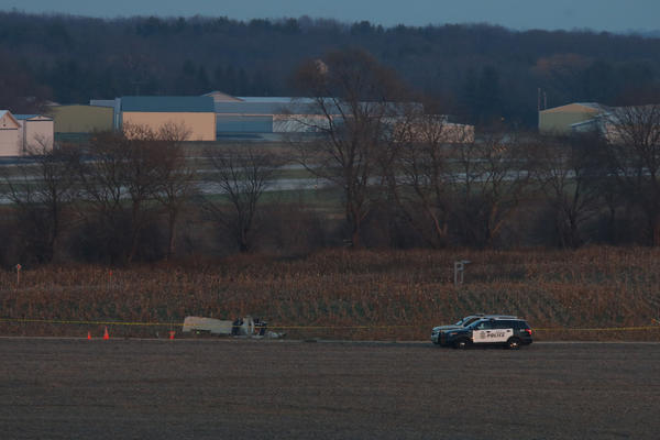 Members of the Burlington Police Department guard the scene of a plane crash in Burlington Wis.