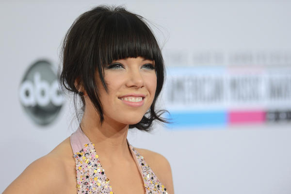 Singer Carly Rae Jepsen poses in the press room at the 40th American Music Awards. Jepen is nominated for New Artist of the Year.