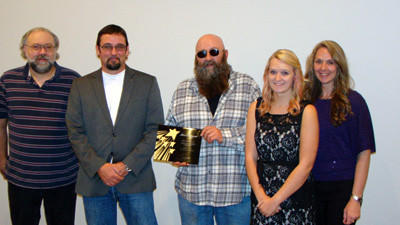 John Goga of Goga¿s Service Station in Cairnbrook, the 2011 winner, is shown presenting Business of the Year winner to Bryanne Enterprises Inc. 2012 Business of the Year.  Pictured are: Michael Meck Sr., Geoffrey Miscoe, John Goga, Bryanne Miscoe and Lori Miscoe.