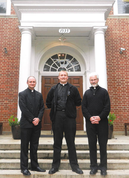 From left, seminarians Jeff Ellis, Paul Kuhn and Patrick Parks are part of the Pastoral Field Education Program at St. Maria Goretti High School.