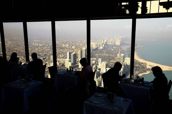 The lunch hour at the Signature Room, 95 floors up in the John Hancock Center, draws a mix of businesspeople and tourists who might feel like they're dining on top of the city.
