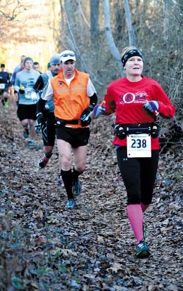 Kathleen Luzier on the Appalachian Trail near Reno Monument Road in Boonsboro during the 2012 JFK 50 Mile Run Saturday. Luzier was able to shave off about 47 minutes from her time last year with her time Saturday of 8:10:27