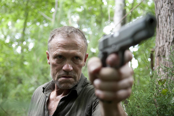 Merle Dixon (Michael Rooker) only points his gun at things he wants to kill.