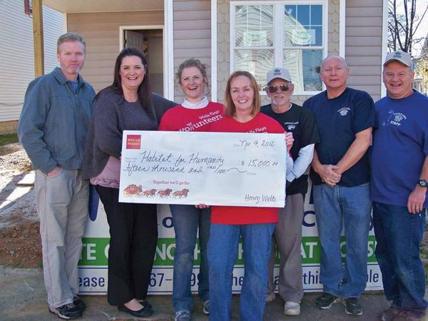 Pictured from left are Mark D. Story, director of Franklin County Habitat; Stephanie Wall, representing the Habitat partner family; Jessica Beardsley and Sandra Bondarenko from Wells Fargo; Ted Tedrick, Andre Bondarenko and Paul Sweeney from Lincoln Lanes.