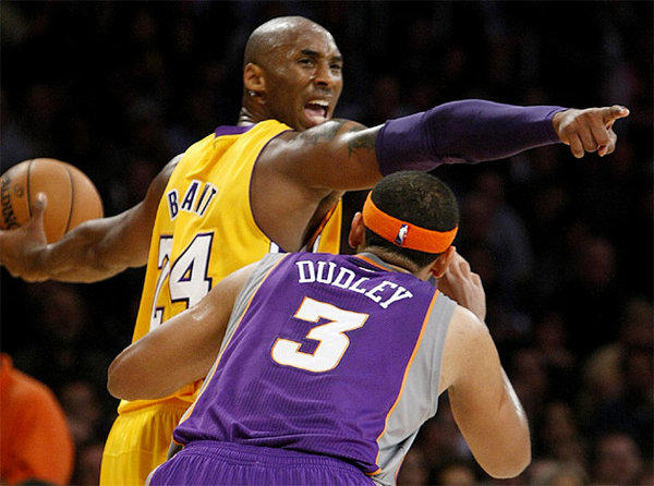 Kobe Bryant directs the offense as Jared Dudley defends.