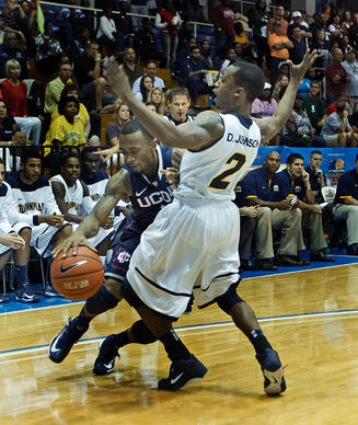 UConn's Ryan Boatright drives against Quinnipiac's Dave Johnson during the first half in the Virgin Island Paradise Jam Tourney.