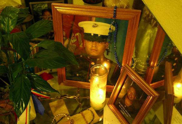 A memorial for Marine Sgt. Rafael Peralta was set up by his family in their San Diego home in 2004. A dispute about whether Peralta, 25, a Mexican immigrant, deserves the Medal of Honor remains one of the last pieces of unfinished business from the U.S. involvement in Iraq.
