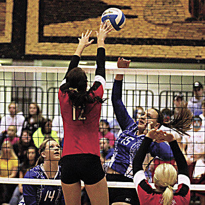 Miranda Ristau (15) of Warner hits over Samantha Boeck of Arlington during the championship match of the state B volleyball tournament Saturday in Mitchell.