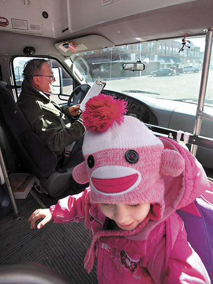 Hailey Pray of Groton makes her way onto the Groton Community Transit bus as driver Doug Doeden looks over the passenger pick-up list last week.