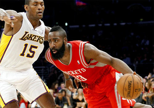 James Harden attempts to drive around Metta World Peace.