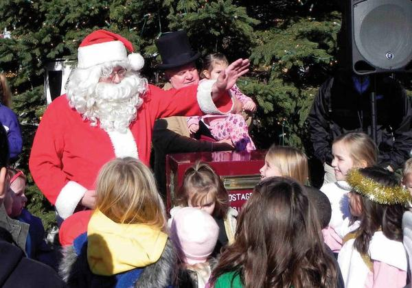Santa Claus waves to his adoring fans during the Greencastle (Pa.) Christmas Parade on Saturday.