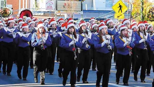 The Waynesboro (Pa.) Area Senior High School marching band makes its way down West Main Street on Saturday afternoon during the Waynesboro Christmas Parade.