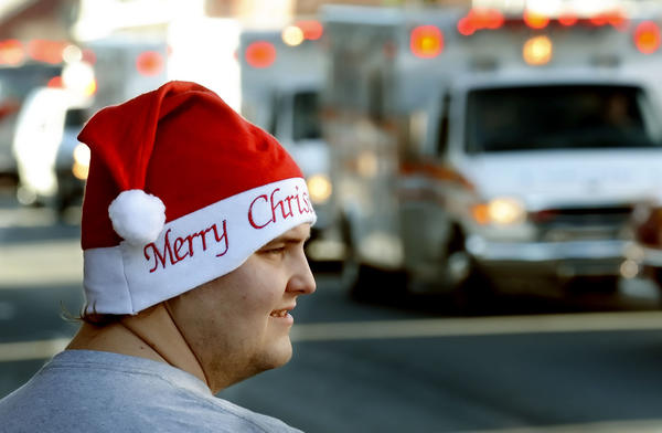 A festive Irvin Seburn, of Warfordsburg, Pa., watches the holiday parade in Waynesboro, Pa., on Saturday. The parade featured several marching bands, including units from Waynesboro Area Senior High, James Buchanan High, Forbes Road High and Southern Fulton High schools.