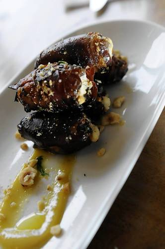 Dates stuffed with goat cheese wrapped in ham with raisin vinaigrette at Grants.