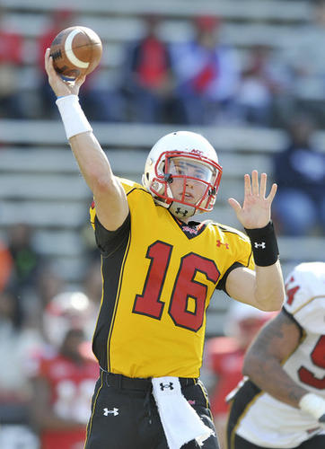Maryland quarterback C.J. Brown throws a pass during the Red and White spring scrimmage.